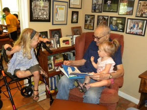 Carl reading to JJ and KK